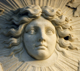 the face of Louis XIV as the Sun King carved in marble